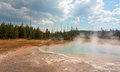 Sunset Lake Under Cumulus Clouds In Black Sand Basin In Yellowstone National Park In Wyoming USA Stock Images - 96654074