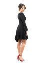 Sophisticated Glamorous Woman In Black Dress Looking Down. Side View. Stock Photo - 96662290