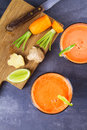 Carrot Ginger Smoothie, Garnished With Lime. Royalty Free Stock Photos - 96663278