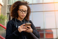 Young Millennial Girl Texting On Her Phone Stock Image - 96683461