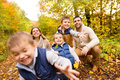 Beautiful Young Family On A Walk In Autumn Forest. Royalty Free Stock Photo - 96696455