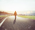 Man Walks On An Unknown Road For A New Adventure Stock Photography - 96709902