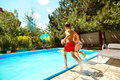 Children Jump Into The Pool In The Summer Royalty Free Stock Photo - 96774975