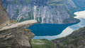 Trolltunga - Famous Rock Formation And Tourist Famous Hike, Beautiful Norwegian Summer Landscape With Fjord, Mountain And Lake Royalty Free Stock Photography - 96785207