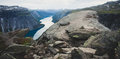 Trolltunga - Famous Rock Formation And Tourist Famous Hike, Beautiful Norwegian Summer Landscape With Fjord, Mountain And Lake Stock Photography - 96785252