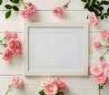 Poster Frame Mockup, Top View, Pink Roses On White Wooden Background.Holiday Concept.Flat Lay. Copy Space Royalty Free Stock Photo - 96795785