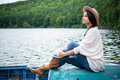 Girl Sitting In A Boat On A Lake Royalty Free Stock Image - 96803856