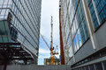 The Tall Business Skyscrapers And The Construction Crane I Royalty Free Stock Image - 96831476