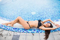 Sexy Woman In Bikini Enjoying Sunbath On The Pool Edge On A Sunny Day, Summer Vocation Royalty Free Stock Photos - 96838048