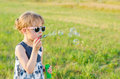 Beautiful Girl Blowing Bubbles In The Park, Free Space. Royalty Free Stock Photo - 96838175