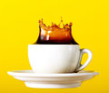Tasty Fresh Black Coffee In Cup Splash Crown On Yellow Vibrant B Royalty Free Stock Image - 96860456