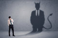 Business Man Looking At His Own Devil Demon Shadow Concept Stock Photography - 96872832