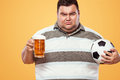 Soccer Fun - Sad And Fat Man At Oktoberfest, Taking Beer And Soccer Ball On Yellow Background. Royalty Free Stock Photos - 96879828