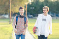 Two Teenagers In A Good Mood With A Skateboard Stock Photo - 96881210