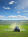 Farming Tractor Plowing And Spraying On Field Royalty Free Stock Images - 9694119