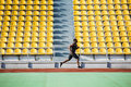 Full Length Side View Of A Sportsman Running On Racetrack Royalty Free Stock Photos - 96938438