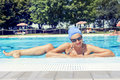 Charming Lady In Swimsuit Posing By The Poolside Stock Photos - 96941013