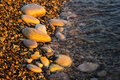 Sea Pebble Beach With Multicoloured Stones, Waves With Foam Royalty Free Stock Image - 96943706