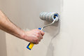 Worker Painting Wall In Room. Painting Walls With A Roller. Stock Photo - 96965700