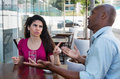 Caucasian Woman In Discussion With African American Man Stock Photos - 96978573