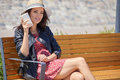 Cheerful Woman In The Street Drinking Morning Coffee In Sunshine Light Royalty Free Stock Image - 96979396