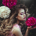 Beautiful Sensual Blonde Woman Posing Near Peony Flowers. Girl With Long Healthy Hair And Clean Skin. Creative Colors Stock Photography - 96990622