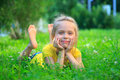 Little Girl Relaxing On Grass Royalty Free Stock Photography - 96994037