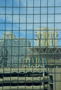 Mirrored Building With Distorted Reflection Royalty Free Stock Image - 978436