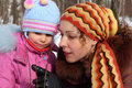 Mother And Daughter In Wood In Winter Closeup Stock Photos - 9704173