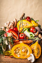 Basket With Various Autumn Seasonal Organic Harvest Vegetables And Pumpkin At Wall Background, Front View. Autumn Food Stock Image - 97010861