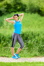 Brunette Woman Doing Stretching Exercises Royalty Free Stock Photography - 97048937