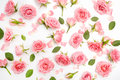 Floral Pattern Made Of Pink Roses, Green Leaves, Branches On White Background. Flat Lay, Top View. Floral Pattern. Stock Photography - 97056522