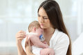 Mother Checking Thermometer With An Ill Baby Stock Images - 97058364