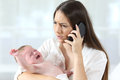 Mother Calling To A Doctor Worried About Her Baby Crying Royalty Free Stock Images - 97058509