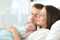 Tired Parents Sleeping With Their Baby Royalty Free Stock Image - 97059756