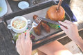 Close Up Of Woman Hands Holding Fork And Knife On The Delicious Burger. American Fast Food In Italian Restaurant On Bali Royalty Free Stock Image - 97061686
