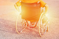Man Hand On Wheel Of Wheelchair At Road In The City Park Use Us Insurance Patient Disability Concept Image Warm Tone Stock Photos - 97067023