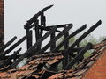 Blackened Roof Rafters Of A Burned Down Residential Building After A Fire Stock Photo - 97068130