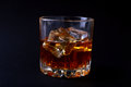 Glass Of Whiskey Or Bourbon With Ice On Black Stone Table. Stock Photos - 97083303