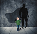 Young Child With His Shadow Of Super Hero On The Wall. Royalty Free Stock Photos - 97131548