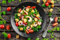 Fresh Healthy Prawns Salad With Tomatoes, Red Onion On Black Plate. Concept Healthy Food Stock Photo - 97158840