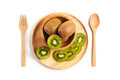 Top View Fresh Kiwi Fruit Sliced In Wooden Plate With Wooden Spo Stock Image - 97160641