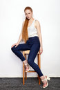 Full Length Portrait Of Young Beautiful Redhead Beginner Model Woman In White T-shirt Blue Jeans Practicing Posing Showing Emotion Royalty Free Stock Images - 97174329