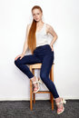 Full Length Portrait Of Young Beautiful Redhead Beginner Model Woman In White T-shirt Blue Jeans Practicing Posing Showing Emotion Royalty Free Stock Image - 97174356
