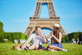 Couple Having Picnic Near The Eiffel Tower In Paris, France Stock Photography - 97183702