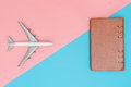 Toy Plane And Leather Notebook On Pink And Blue Stock Photography - 97184032