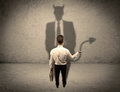 Salesman Facing His Own Devil Shadow Royalty Free Stock Image - 97204066