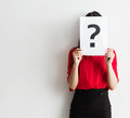Beautiful Young Business Woman Holding A Question Mark Royalty Free Stock Photo - 97219515