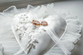 Heart-shaped Pillow With Lace Wedding Gold Rings Royalty Free Stock Image - 97228106