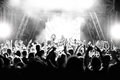Silhouettes Of People At A Concert In Front Of The Scene In Bright Light. Black And White Stock Photography - 97242032